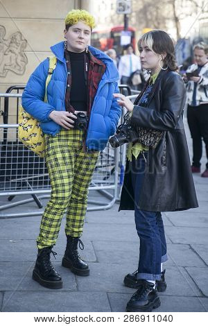 London - February 15, 2019: Stylish Attendees Gathering Outside 180 The Strand For London Fashion We
