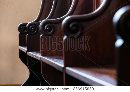 Detail Of Traditional Hard Wood Courthouse Jury, Church Choir Sitting Area. Interior With Empty Wood
