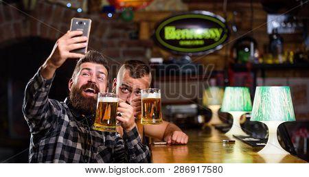 Taking Selfie Concept. Send Selfie To Friends Social Networks. Man In Bar Drinking Beer. Take Selfie