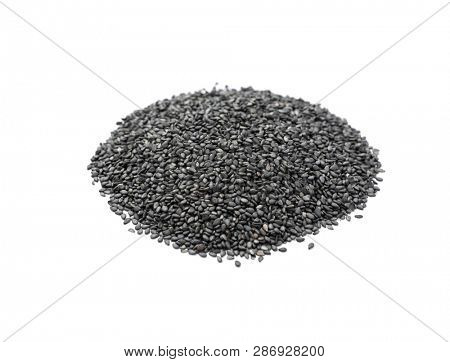 Pile of black organic sesame seeds on white background