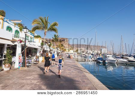 Puerto De Mogan, Spain - February 24, 2019 : Tourist Visiting Puerto De Mogan Marina, Small Fishing