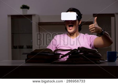 Male student with virtual glasses late at home