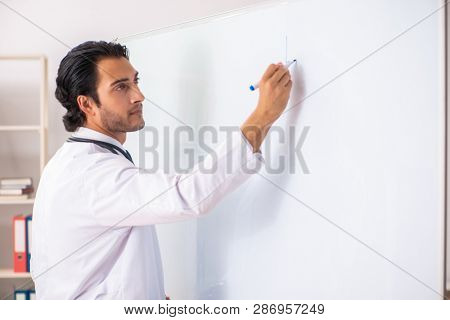 Young doctor in front of whiteboard