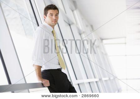 Businessman Standing In A Modern Office