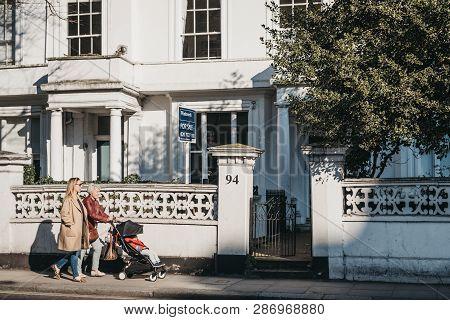 London, Uk - February 23, 2019: People Walking Past