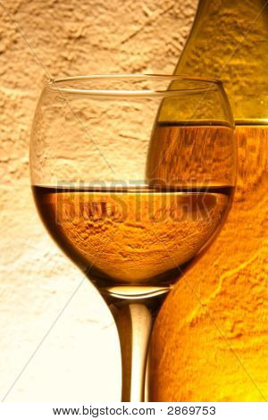 Glass Of White Wine And Bottle