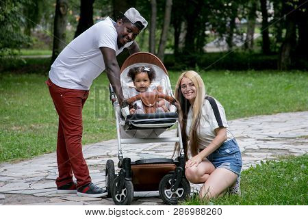 Happy Diverse Family With Daughter At Park. Beautiful Diverse Family