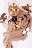 Chocolate Brown Icecream Cookie Dessert Flat Lay. Cold Delicious Ice Cream Ball and Biscuit on Textile Background Top Down View. Gelato Portion Serving Closeup Vertical Copy Space Banner poster