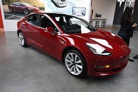 Tesla Red Model 3 All Electric Car On Display At A Tesla Car Dealership, Chicago, Il November 24, 20