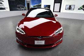 Tesla Deep Red Model S 100d All Electric Car On Display At A Tesla Car Dealership, Chicago, Il Novem