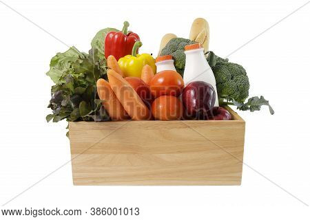 Wooden Crate With Multi Color Vegetables , Fruit, Milk And Baguette Isolated On White Bakcground. Gr