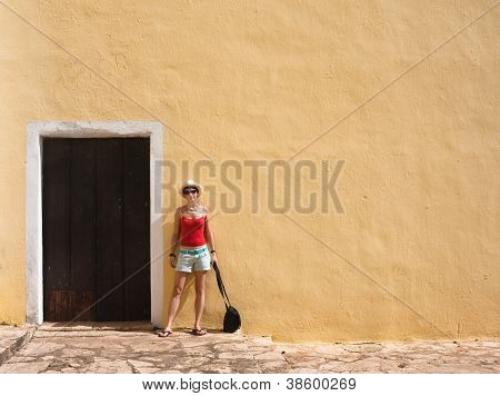 Girl On The Background Of The Wall