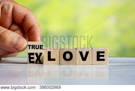 The Hand Turn Wooden Block And Change Word