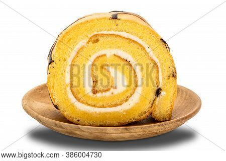 Sliced Cake Roll In Wooden Plate On White Background With Clipping Path.