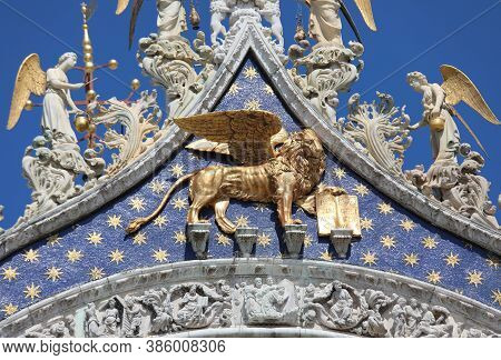 Large Lion With Wings Made Of Gold On The Facade Of The Basilica Of San Marco In Venice, Symbol Of T