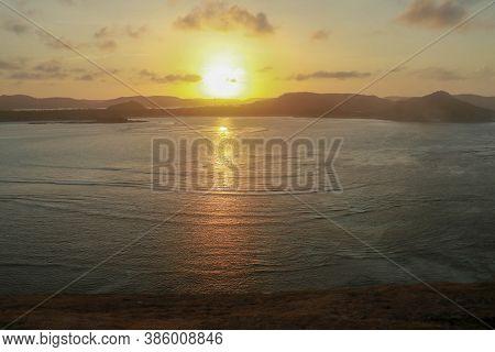 Sunrise View From Rock At Tanjung Aan. Rising Sun Over Tanjung Aan Bay, Lombok, Indonesia. Reflectio