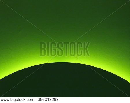Gradient Colour Green Light In Background And Part Of A Dark Green Disc Or Sphere In Front Of It. Co