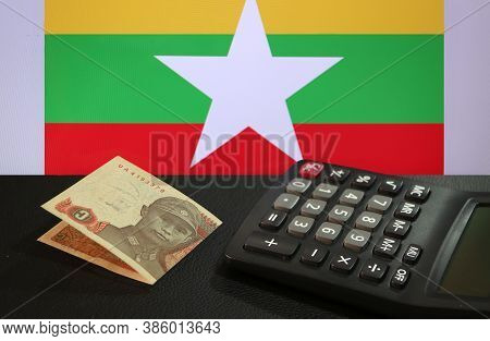 One Of Banknote Currency Myanmar Kyats With Calculator On The Black Floor With The Union Of Myanmar