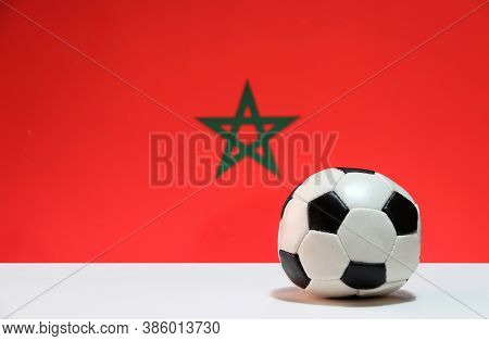 Small Football On The White Floor And Moroccan Nation Flag Background. The Concept Of Sport, Morocco