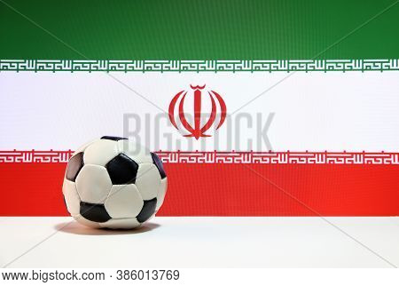 Small Football On The White Floor And Iranian Nation Flag Background. The Concept Of Sport, Iran Is
