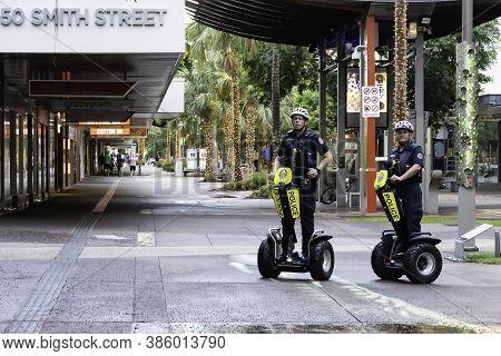 Darwin, Australia - March 14th, 2020: Two Policemen Riding Segways, Patrolling The Streets Of Darwin