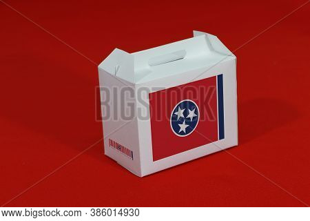 Tennessee Flag On White Box With Barcode And The Color Of State Flag On Red Background. The Concept