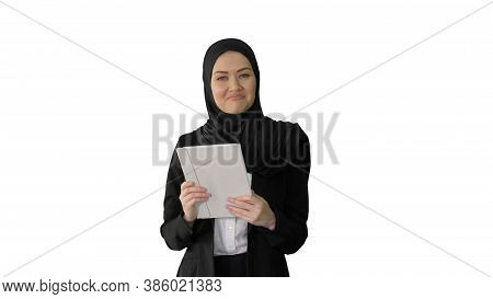 Arabian Businesswoman In Hijab Using Tablet Computer While Walki