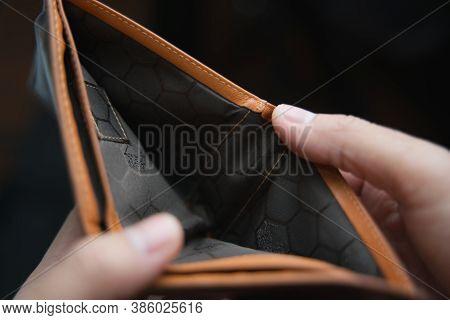 Man Hand Open An Empty Wallet, Close-up