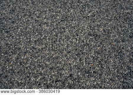 Tiny Gravel Texture On Grey Concrete Wall. Texture Background Seamless Gravel Floor. Selective Focus