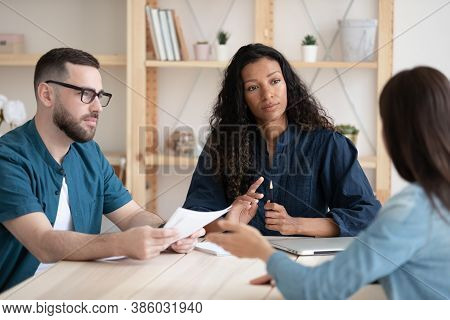 Two Diverse Hr Managers Holding Job Interview With Candidate