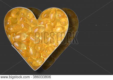 Garlic Pills In Metal Heart Reflected On Dark Grey Surface
