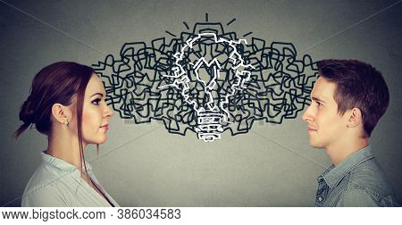 Young Man And Woman Looking At Each Other