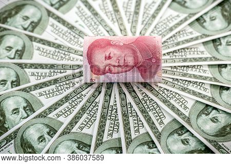 100 Dollar Banknotes With One Hundred Yuan Banknote (renminbi), Concept Of Devaluation Of The Chines