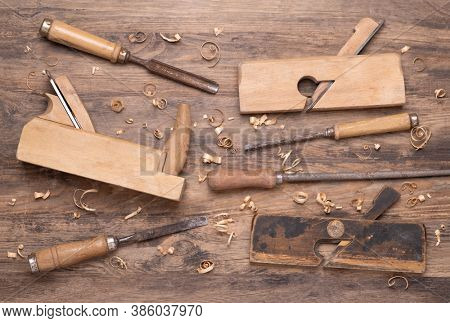 Collection of vintage carpententry tools on old wooden background
