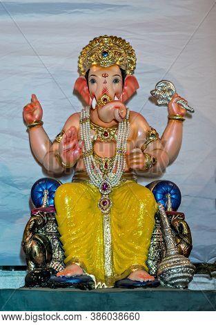 Freshly Made, Painted, Hand Crafted Clay Idol Of Hindu God Lord Ganesha.