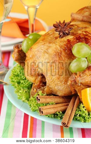 roastes chicken with grapes, lettuce and spices close-up. Thanksgiving Day