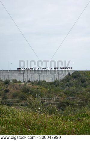 Alqueva Dam Phrase On A Clear Day You Can See Forever On Green Landscape And Cloudy Day In Alentejo,