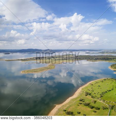 Lake Reservoir Water Reflection Drone Aerial View Of Alqueva Dam Landscape And In Alentejo, Portugal