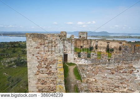 Mourao Castle Towers And Wall Historic Building With Alqueva Dam Reservoir In Alentejo, Portugal