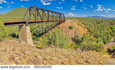 Wide Angle Photo Of An Old Railroad Trestle Bridge Spanning Bear Canyon Near Perkinsville Arizona In
