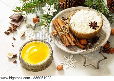 Seasonal Baking Winter Background. Ingredients For Christmas Baking - Chocolate, Spices, Nuts, Flour