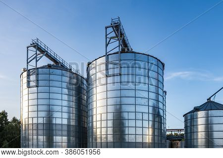 Modern Granary Elevator With Silver Silos On Agro-processing And Manufacturing Plant For Processing