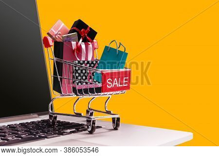 Boxes In A Trolley On A Laptop Keyboard. Ideas About Online Shopping, Online Shopping Is A Form Of E