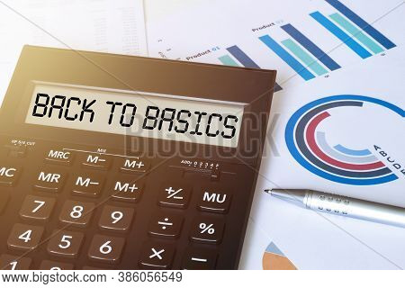 Word Back To Basics On Calculator. Business And Finance Concept