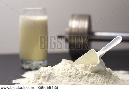 Scoop Of Whey Protein, Sports Nutrition, Supplement, Dumbbell And A Glass With A Cocktail For Gain M