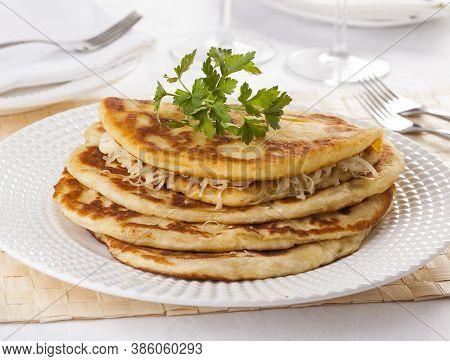 Langos, Traditional Hungarian Pancake With Cheese At Restaurant.