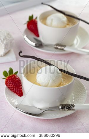 Floating Island, In French Ile Flottante Is A Dessert Of Meringue Floating On Crème Anglaise. The Hu