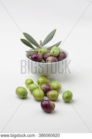 Freshly Picked Olives In A Bowl Isolated On White