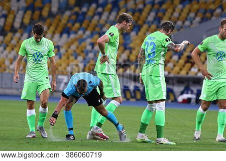 Kyiv, Ukraine - August 5, 2020: Referee Ivan Kruzliak (svk) Applying Vanishing Spray Before A Free K