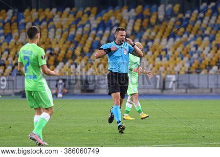 Kyiv, Ukraine - August 5, 2020: Referee Ivan Kruzliak (svk) Shows Yellow Card To Player During The U